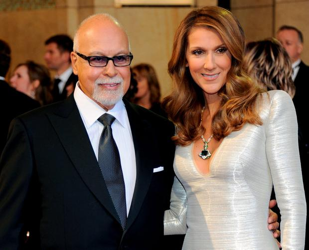 Rene Angelil (L) and his wife, singer Celine Dion, arrive at the 83rd Annual Academy Awards at the Kodak Theatre February 27, 2011 in Hollywood, California. (Photo by Ethan Miller/Getty Images)