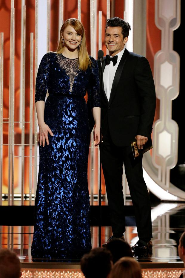 Presenters Bryce Dallas Howard and Orlando Bloom speak onstage during the 73rd Annual Golden Globe Awards at The Beverly Hilton Hotel on January 10, 2016 in Beverly Hills, California. (Photo by Paul Drinkwater/NBCUniversal via Getty Images)