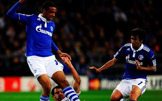 Joel Matip and Raul Gonzalez of Schalke are challenged by Dejan Stankovic