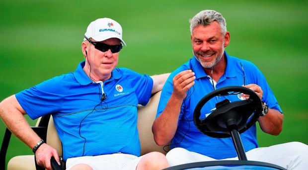 Darren Clarke, captain of team Europe, looks happy during the first day's fourball matches at the EurAsia Cup
