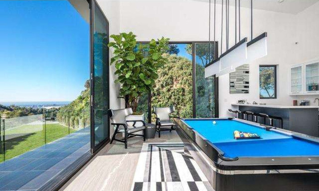John Legend and Chrissy Teigan have snapped up a home once owned by Rihanna