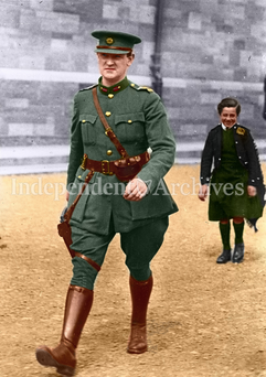 Michael Collins strides through Cathal Brugha Barracks, Dublin. A young civilian piper, Alphonsus Culloten, follows in tow. The shot was taken on Collins return from a memorial service on the 7 August, 1922. Just over two weeks later, he was shot dead by anti-Treaty forces in Cork.