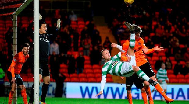 Celtic's Leigh Griffiths attempts an overhead kick during the Ladbrokes Scottish Premiership match at Tannadice Park