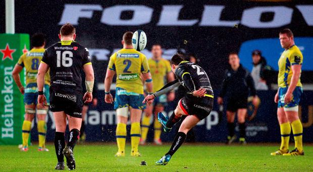 Ospreys Sam Davies kicks a penalty during the European Champions Cup, pool two match at the Liberty Stadium