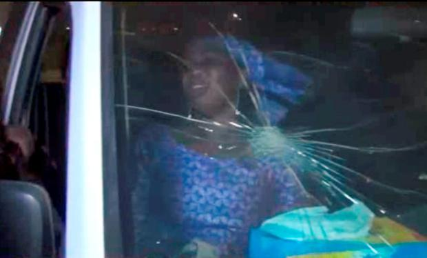 In this image taken from video from AP Television, a rescued woman sits in a vehicle with bullet hole in windshield near the Splendid Hotel (AP Television via AP)
