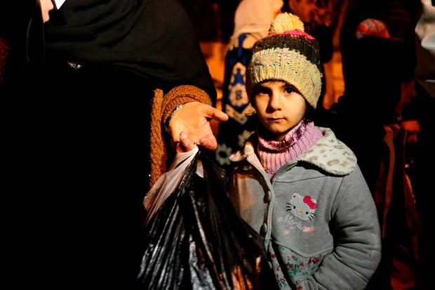A Syrian girl waits with her family, who say they have received permission from the Syrian government to leave the besieged town, as they depart after an aid convoy entered Madaya REUTERS/Omar Sanadiki