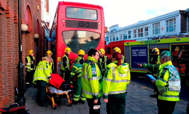 A number of people are being assessed by medics following the crash which happened at about 7.35am in London Road, Enfield, north London Credit: London Ambulance Service/PA Wire