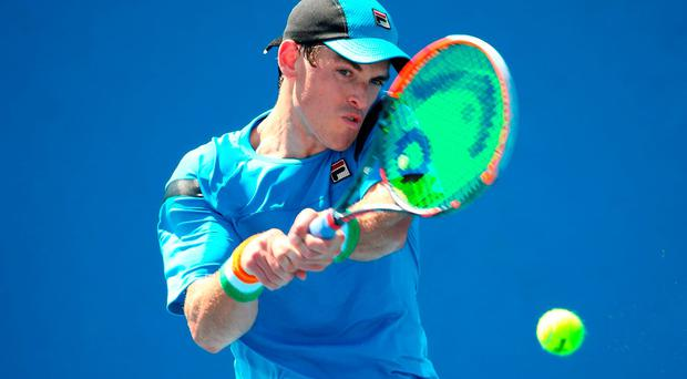 James McGee of Ireland plays a backhand in his match against Daniel Brands of Germany during the third round of 2016 Australian Open Qualifying at Melbourne Park