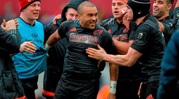 16 January 2016; Munster's Simon Zebo is congratulated by team-mates after scoring his side's third try of the match. European Rugby Champions Cup, Pool 4, Round 5, Munster v Stade Francais. Thomond Park, Limerick. Picture credit: Matt Browne / SPORTSFILE