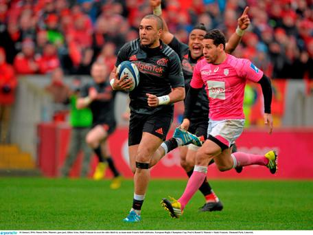 16 January 2016; Simon Zebo, Munster, goes past, Julien Arias, Stade Francais to score his sides third try as team-mate Francis Saili celebrates. European Rugby Champions Cup, Pool 4, Round 5, Munster v Stade Francais. Thomond Park, Limerick.