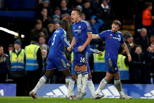 Chelsea's English defender John Terry (C) celebrates scoring a late equalising goal to make the score 3-3 during the English Premier League football match between Chelsea and Everton at Stamford Bridge