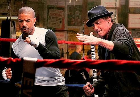 Packing a punch: Silvester Stallone is back as Rocky training Apollo Creed's son played by Michael B Jordan.