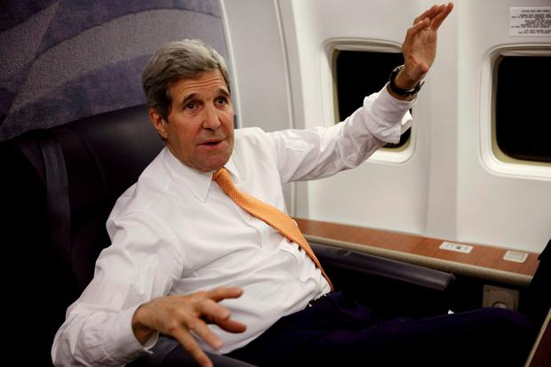U.S. Secretary of State John Kerry speaks to journalists about his negotiations with Iran upon his arrival from Vienna at Joint Base Andrews in Washington (Kevin Lamarque/Pool Photo via AP)