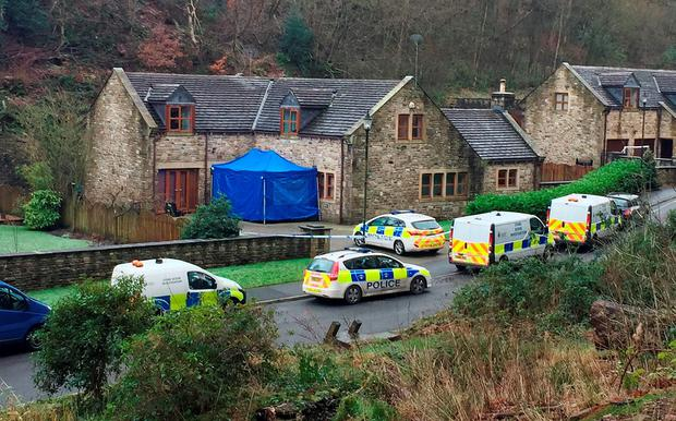 Police outside a house on Sunny Bank Road in Helmshore, Lancashire as a murder investigation has been launched after a 60-year-old woman was found dead Credit: Pat Hurst/PA Wire