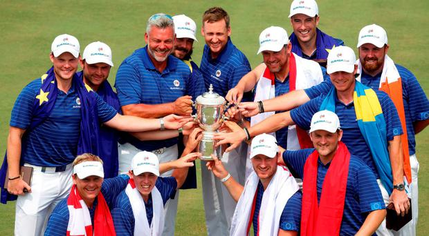 Team Europe celebrating with the trophy on day three of the EurAsia Cup golf tournament at the Glenmarie Golf and Country Club in Shah Alam, west of Kuala Lumpur.