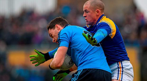 Paddy Andrews, Dublin, in action against Dermot Brady, Longford. Bord na Mona O'Byrne Cup Semi-Final, Longford v Dublin. Glennon Brothers Pearse Park, Longford. Picture credit: Ray McManus / SPORTSFILE