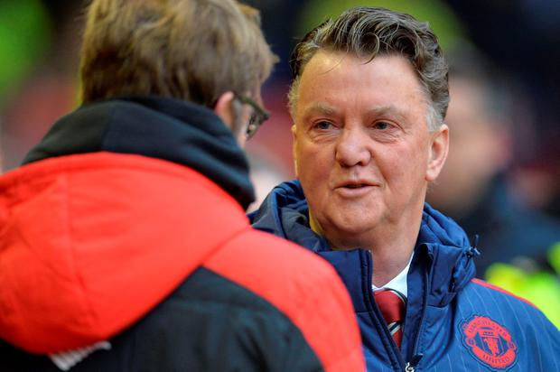 Liverpool manager Jurgen Klopp (L) greets Manchester United boss Louis van Gaal (R) ahead of the game