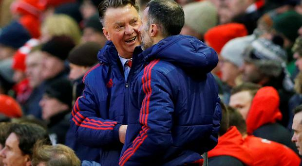 Manchester United's manager Louis van Gaal shakes hands with assistant manager Ryan Giggs as they celebrate at full time