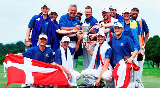 The European team with captain Darren Clarke celebrate with the trophy after winning the EurAsia Cup. Photo: Stuart Franklin/Getty Images