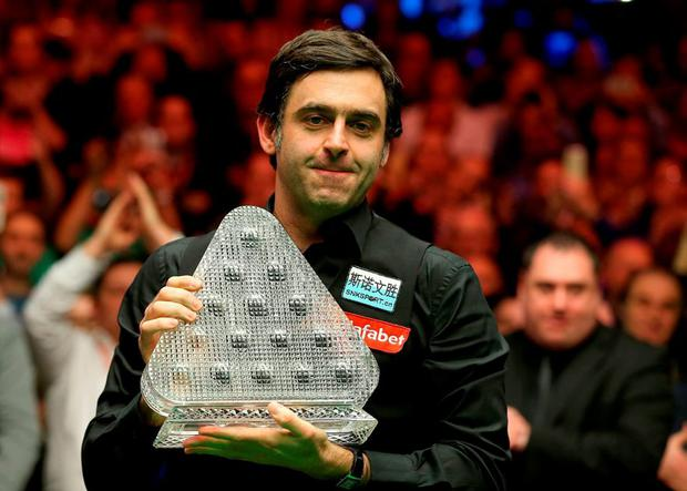 Ronnie O'Sullivan celebrates with the trophy during day eight of the Dafabet Masters 2016 at Alexandra Palace