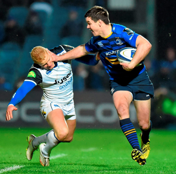 Leinster's Johnny Sexton hands off Bath's Tom Homer. Photo: Stephen McCarthy / SPORTSFILE