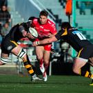 Toulon's Australian winger Drew Mitchell, centre, is tackled by Wasps' defenders during their European Champions Cup match at the Mayol stadium in Toulon. Photo: Bertrand Langlois/AFP/Getty Images