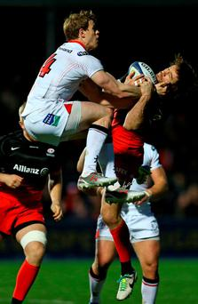 Ulster's Andrew Trimble and Marcelo Bosch of Saracens challenge for a high ball. Photo: Steve Bardens/Getty Images.