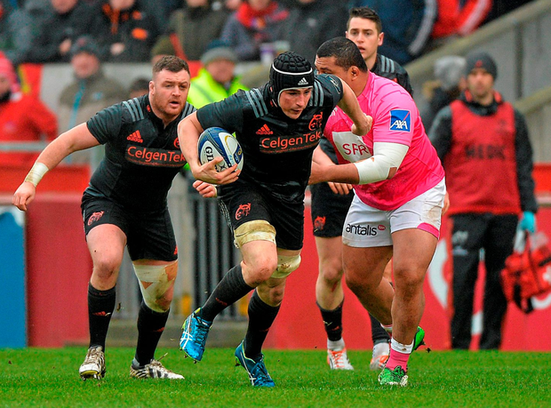 Munster's Tommy O'Donnell is tackled by Stade Francais player Zak Taulafo. Photo: Matt Browne / SPORTSFILE