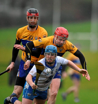 Waterford's Brian Nolan attempts to get away from Clare duo Paul Flanagan (right) and Darach Honan in Carriganore. Picture credit: Matt Browne / Sportsfile