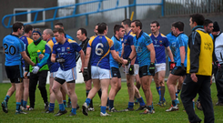 Dublin and Longford players shake hands after the game. Picture credit: Dean Cullen / Sportsfile