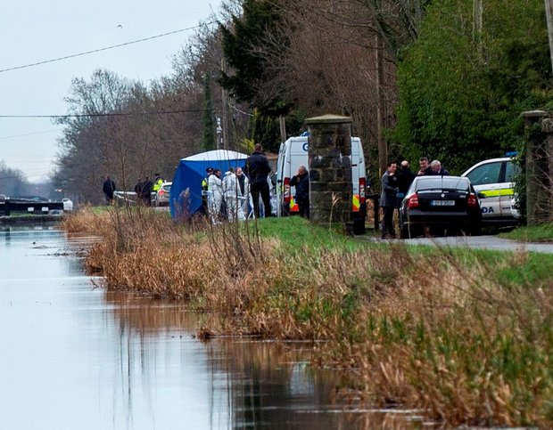Gardaí at the scene where the body was found in the Grand Canal Photo: Douglas O'Connor