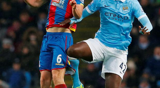 Manchester City's Yaya Toure in action against Crystal Palace's Scott Dann at the Etihad Stadium. Photo: Reuters / Phil Noble.