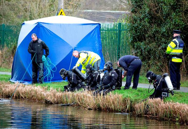 Members of the Garda underwater unit prepare to trawl the Grand Canal near the village of Ardclough, Co Kildare, after a man's torso was found inside a suitcase dumped in the water Photo: Brian Lawless/PA Wire
