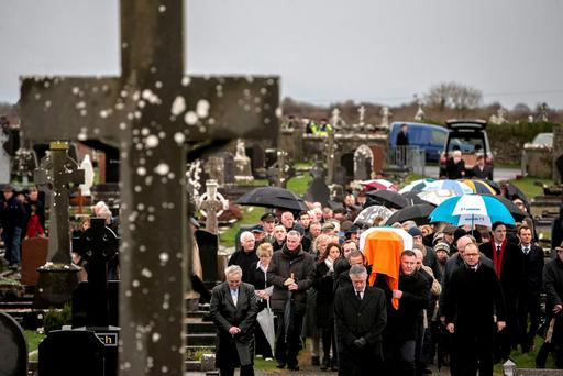 The funeral cortege carrying the Tricolour-draped coffin of PJ Mara makes its way into the Mount Cross Cemetery in Kinvara, Co Galway Photo: Mark Condren