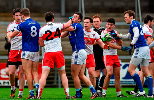 Derry and Cavan players tussle during yesterday's game in Armagh. Picture credit: Philip Fitzpatrick / Sportfile
