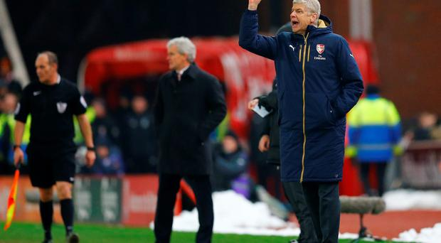Arsene Wenger attempts to make his point on the sideline. Photo: Reuters