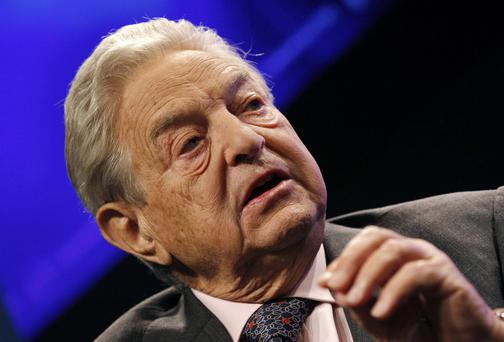 "They'll be meeting a couple of weeks after billionaire George Soros (pictured), a Davos stalwart, warned that the China-induced turmoil in financial markets is starting to remind him of ""the crisis we had in 2008"". Photo: Reuters"