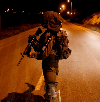 An Israeli soldier guards near the Jewish settlement of Otniel in the West Bank Photo: REUTERS/Ronen Zvulun