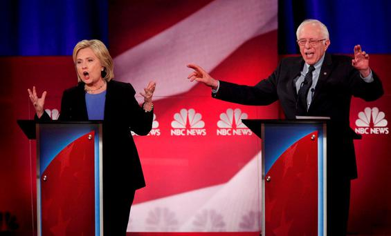 Democratic U.S. presidential candidate and former Secretary of State Hillary Clinton and rival candidate U.S. Senator Bernie Sanders speak simultaneously at the NBC News - YouTube Democratic presidential candidates debate in Charleston, South Carolina REUTERS/Randall Hill