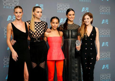 Actresses Rosie Huntington-Whiteley, Abbey Lee, Zoe Kravitz, Courtney Eaton and Riley Keough (L-R) pose backstage with the award for Best Director on behalf of George Miller for