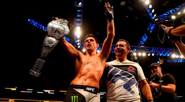 Dominick Cruz celebrates defeating T.J. Dillashaw (not pictured) to win the World Bantamweight Championship during UFC Fight Night 81 at TD Banknorth Garden