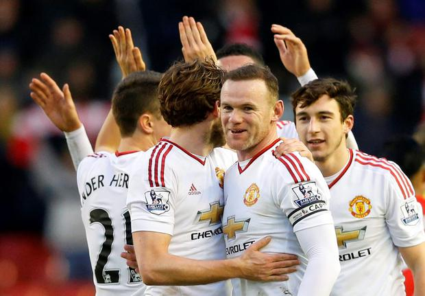 Manchester United's Wayne Rooney celebrates at full time with teammates Action Images via Reuters / Carl Recine
