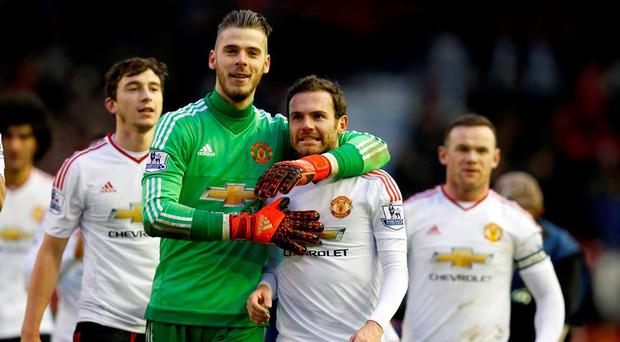 Manchester United goalkeeper David De Gea and Juan Mata celebrate after the final whistle during the Barclays Premier League match at Anfield