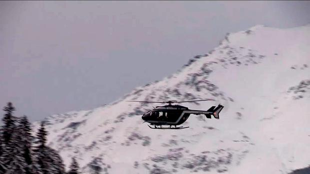 An image grab taken from a video released by Le Dauphine shows a helicopter hovering over the site of an avalanche that killed five French Foreign Legionnaires near the resort of Valfrejus in the French Alps on January 18, 2016.