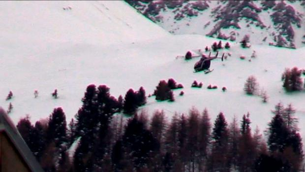 An image grab taken from a video released by Le Dauphine shows a helicopter hovering over the site of an avalanche that killed five French Foreign Legionnaires near the resort of Valfrejus in the French Alps on January 18, 2016