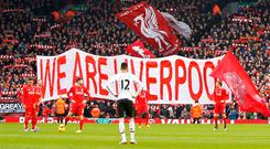 Liverpool fans display a banner before the start of the match with Manchester United