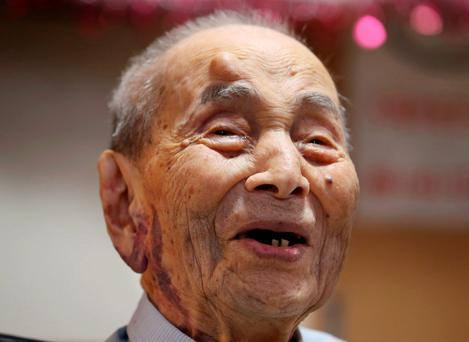File photo: Yasutaro Koide smiles upon being formally recognized as the world's oldest man by the Guinness World Records at a nursing home in Nagoya, central Japan. (AP Photo/Koji Sasahara, File)