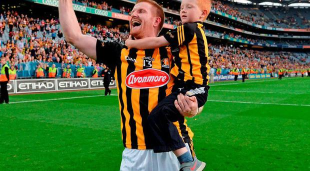 Kilkenny's Richie Power, with his son Rory, celebrates victory in the 2014 All-Ireland final against Tipperary