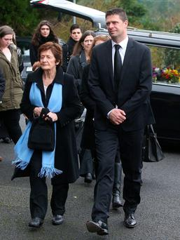 Billy Quinn's wife Mary and son Niall arrive at the church in Killenaule, Co Tipperary. Picture credit; Damien Eagers