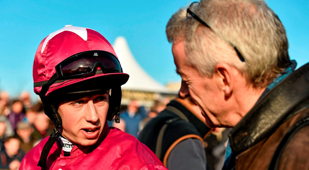 Michael O'Leary (right) believes Bryan Cooper should take his time before deciding which of his horses to ride in the Gold Cup (SPORTSFILE)